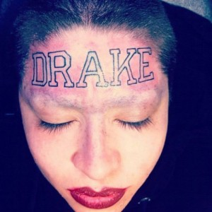 "Woman Gets ""DRAKE"" Tattooed On Forehead"