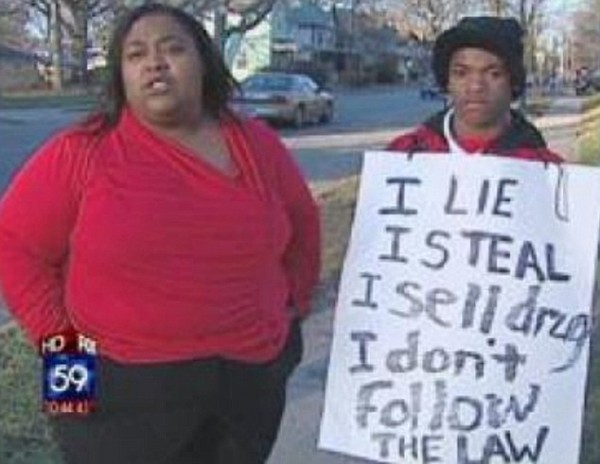 Mother Punishes Son By Making Him Stand On The Corner With Sign Around His Neck Saying 'I lie, I steal, I sell drugs'