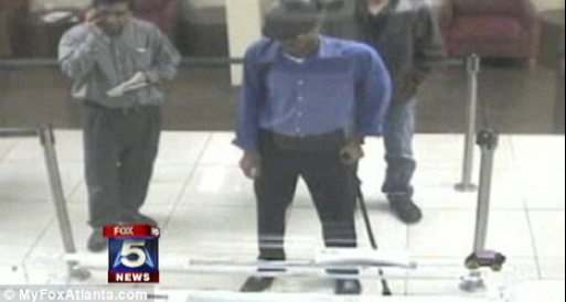Stupid Bank Robber Returns To Bank To Get Money For Cab [VIDEO]