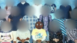 "Black Smiley Face in School Photo Called ""Offensive"""