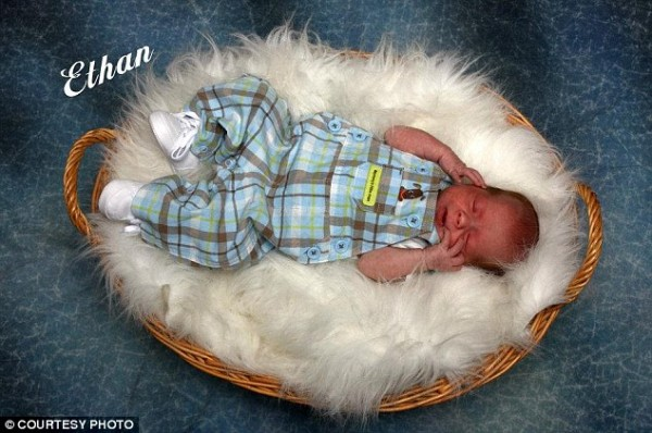 Baby boy, two months old, dies 'after his father lifted him by the head and threw him onto a chair'