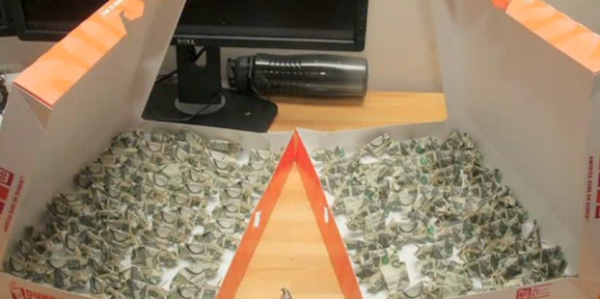 YouTube video by user Bacon Moose shows the man paying for a $137 traffic fine with 137 origami dollar bill pigs. To make matters more interesting, he brought the pigs in two doughnut boxes.