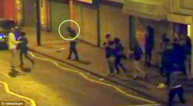 Caught on camera: Chilling moment killer calmly tucks pistol into his waist band seconds after gunning down rival in hail of six bullets