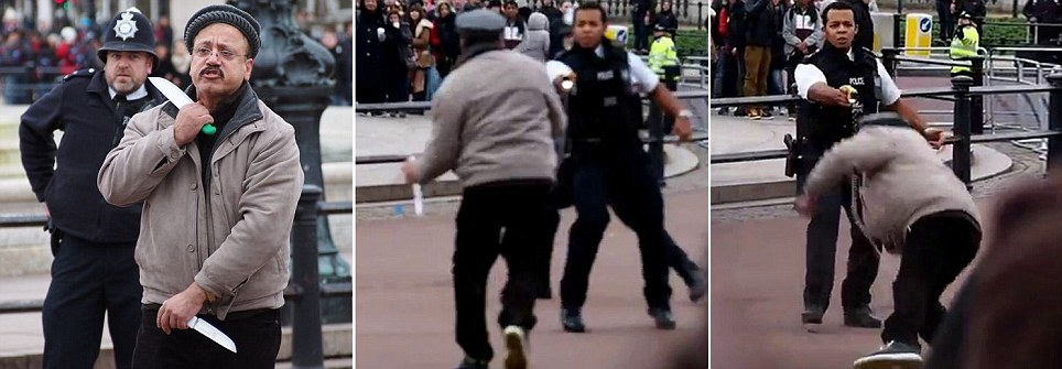 Shocking footage shows man holding six-inch knife to his throat before being tasered by police as he ran towards them wielding two blades during Changing of the Guard at Buckingham Palace