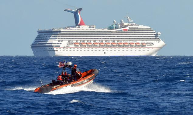 Foul conditions aboard stranded Carnival cruise ship Triumph: Passengers describe 'sewage running down the walls' and people acting like 'savages'