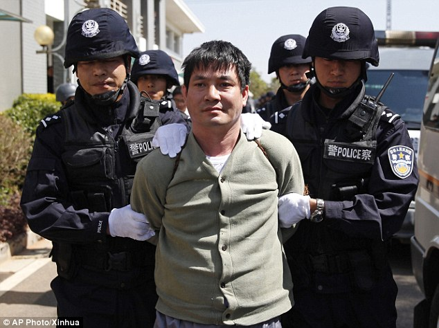 'I miss my mum. I don't want my children to be like me. I am afraid of death': Final whimper of drug lord as he is executed with three accomplices after being paraded on TV in China