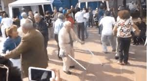 Old man rocking, throws down crutches- There goes his insurance claim