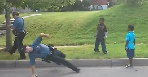 Cop loses dance-off with neighborhood children